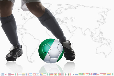 dribble: Soccer player dribble a soccer ball with Nigeria flag
