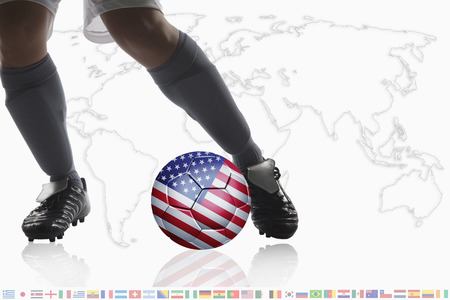 dribble: Soccer player dribble a soccer ball with USA flag