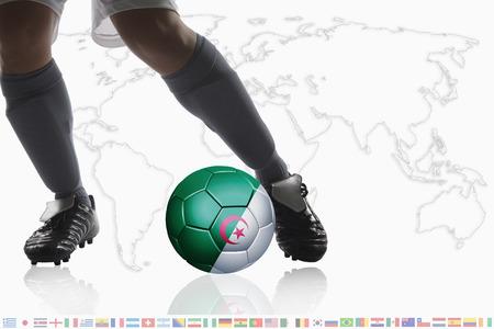 dribble: Soccer player dribble a soccer ball with Algeria flag