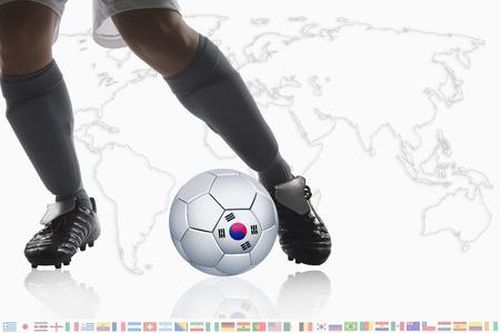 dribble: Soccer player dribble a soccer ball with Korea Republic flag