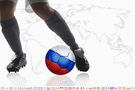 masculinity: Soccer player dribble a soccer ball with Russia flag