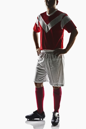 hands on waist: A soccer player with hands on waist