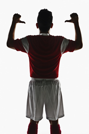 A soccer player showing his back