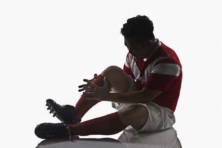 A soccer player get injured photo