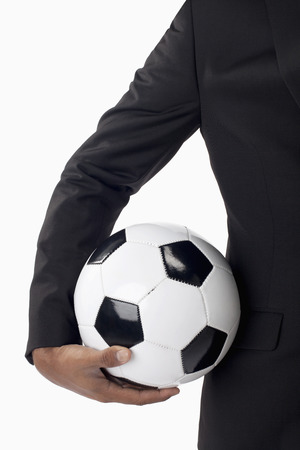 individual sports: Soccer manager holding a ball