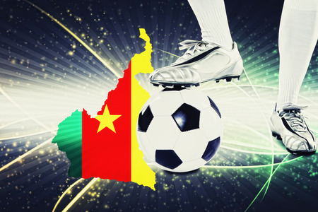 kick off: Cameroon soccer player ready for kick off Stock Photo