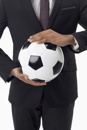 Soccer manager holding a ball photo