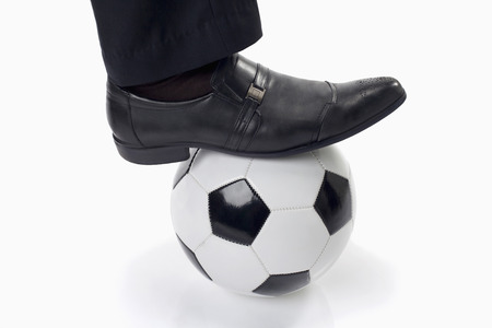 Soccer manager with a ball under his feet photo