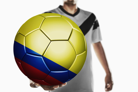 colombia flag: A soccer player holding Colombia soccer ball