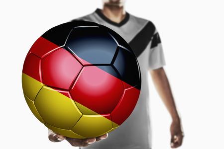 bannière football: Un joueur de football tenant Allemagne ballon de football Banque d'images