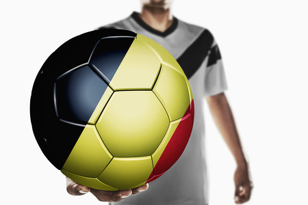 individual sports: A soccer player holding Belgium soccer ball