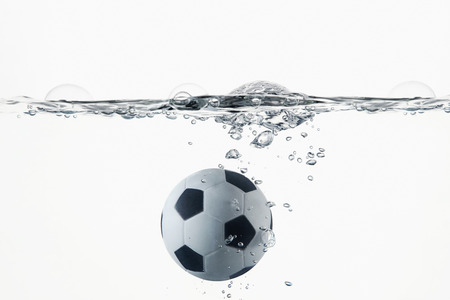 ball on water: Soccer ball splashing into water Stock Photo