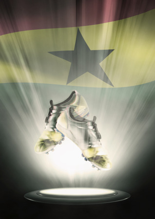 football cleats: Football cleats with Ghana flag backdrop