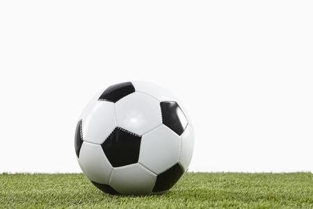 playing field: Soccer ball on a playing field Stock Photo