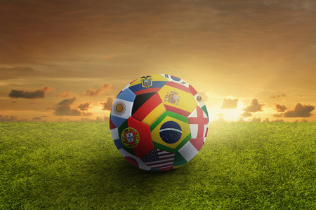 World flags soccer ball on a playing field photo