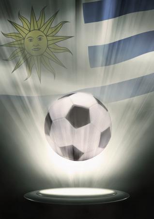 bandera de uruguay: Un balón de fútbol con la bandera de Uruguay telón de fondo Foto de archivo