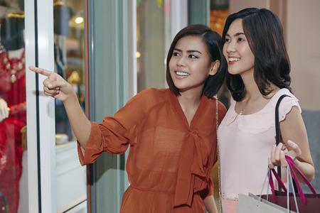 south asian ethnicity: Two young women window shopping