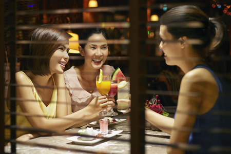 Young women cheers their drinks