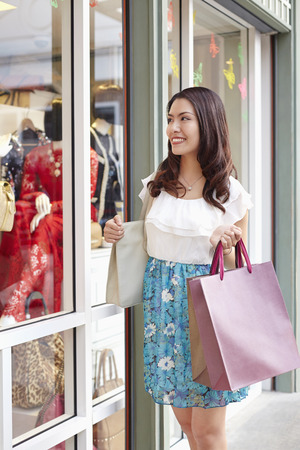 south asian ethnicity: Girl going for window shopping