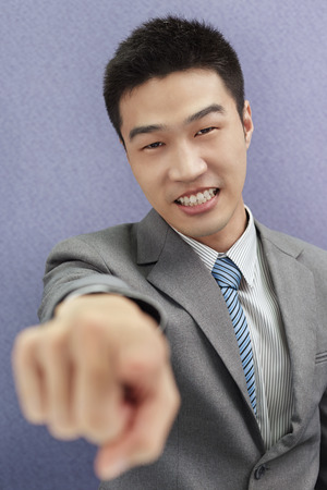 south asian ethnicity: Businessman pointing at camera