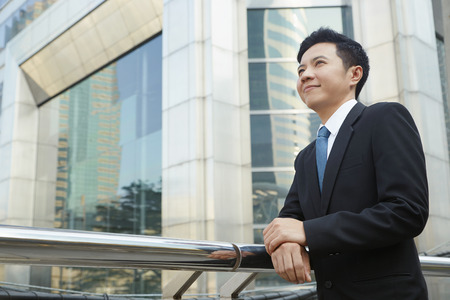 south asian ethnicity: Businessman standing outside of office