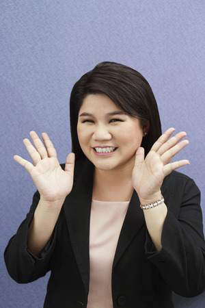 hand gesture: Smiling businesswoman with hand gesture