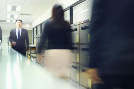collegue: Blur motion of businessman and businesswoman walking Stock Photo
