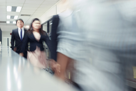 south asian ethnicity: Blur motion of businessman and businesswoman walking Stock Photo