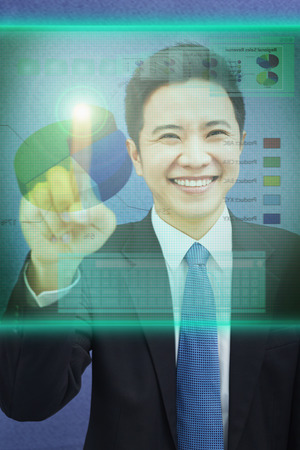 south asian ethnicity: Businessman with a touchscreen infographic