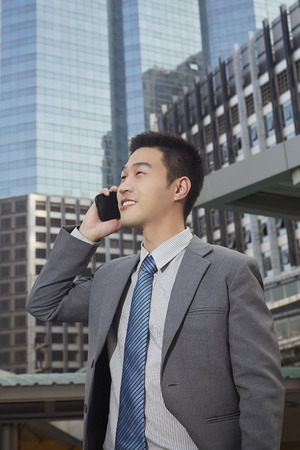 south asian ethnicity: Businessman talking on the phone