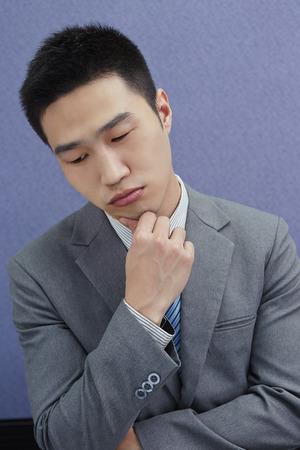 south asian ethnicity: Businessman looking sad Stock Photo
