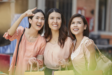 south asian ethnicity: Young women with shopping bags Stock Photo