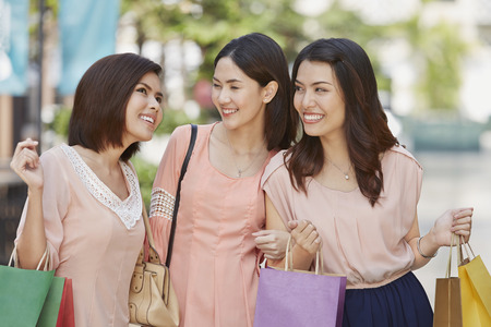 south asian ethnicity: Young women shopping together Stock Photo