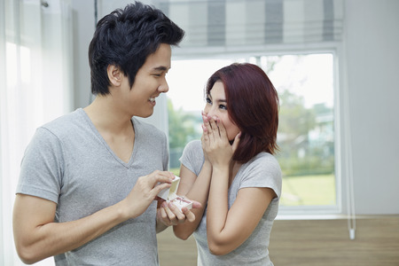 south asian ethnicity: Boyfriend give his girlfriend a present Stock Photo