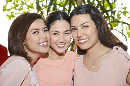 three people only: Young women smiling