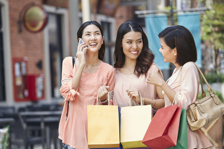 Young women shopping together Stock Photo