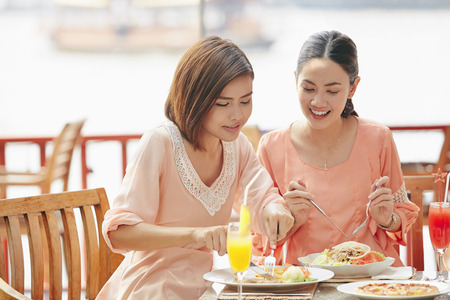 south asian ethnicity: Young women having lunch together
