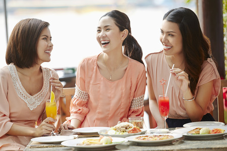 three people only: Young women having lunch together