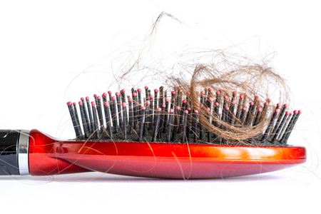 hair tuft: Comb hair with tufts, bundle of hair, lots of hair on the hairbrush closeup on a white background