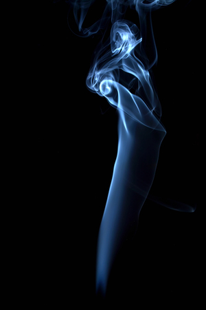 blue smoke: blue smoke on black background Stock Photo