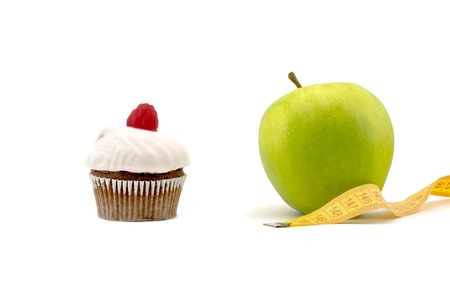 Green apple and cake with centimeter isolated on a white background Stock Photo