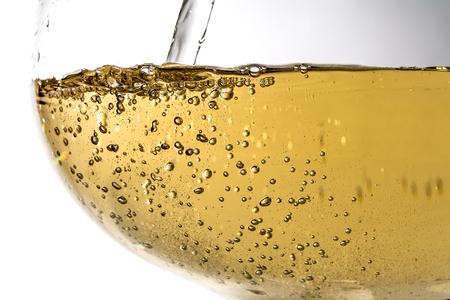 Stream of wine being pouring into a glass closeup, wine, splashing, splash, bubbles, fizz Stock Photo