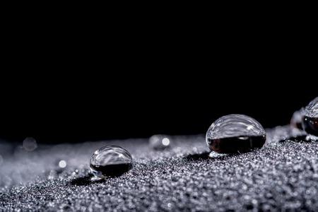 Drops of water close-up macro on velvet material 写真素材