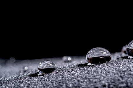 Drops of water close-up macro on velvet material Standard-Bild