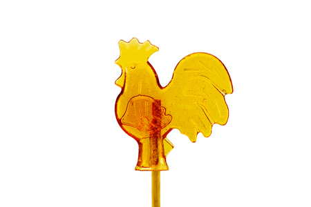 candy on a stick in the form of a rooster isolated on a white background