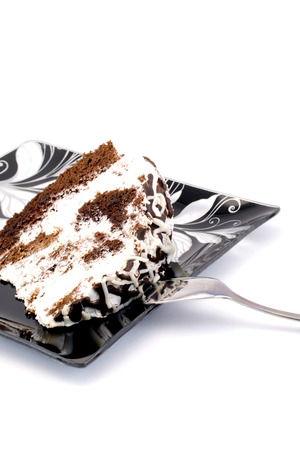 piece of cake on a plate with a spoon isolated Stock Photo