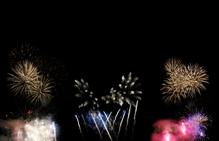 Fireworks isolated on black background with free space for text