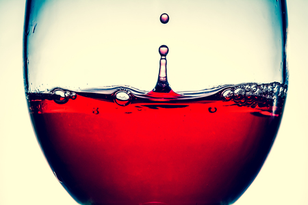Red wine splash in the wineglass close-up macro texture background. Vintage old retro style view. Stock Photo