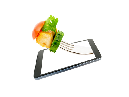 A conceptual creative 3D volumetric photo of a fork with a piece chicken fried meat with vegetables close-up protruding, outside the screen of a smartphone isolated on a white background.