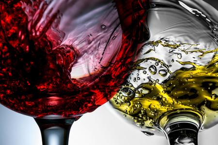 Red and white wine splash in wineglasses close-up macro. Stock Photo